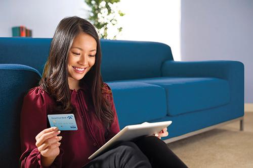 Woman using her debit card online.