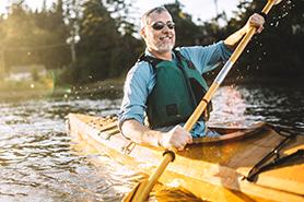 Man over 50 years old kayaking
