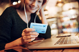 Woman using a HomeTrust card to make an online purchase
