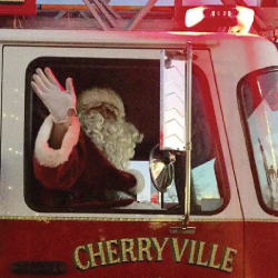 Santa waiving from a fire truck