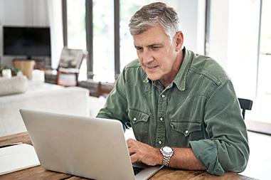 Man using his laptop computer..