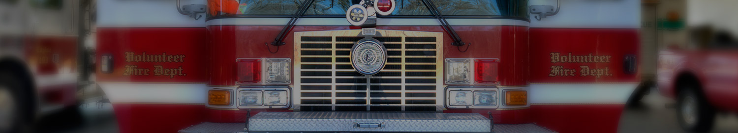 Fire truck parked in a fire station.