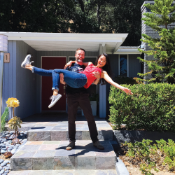 Excited couple in front of new home