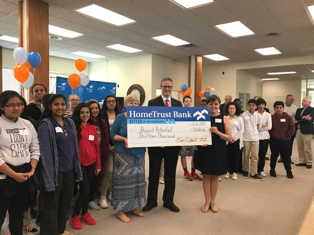 HTB Market President presents check to students