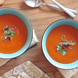 Tomato soup in blue bowls