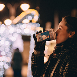 Woman drinking coco outside