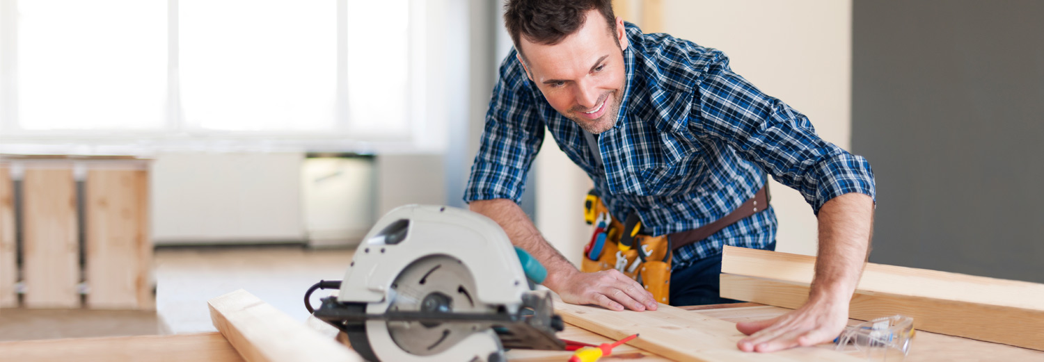Man cutting wood for a home project